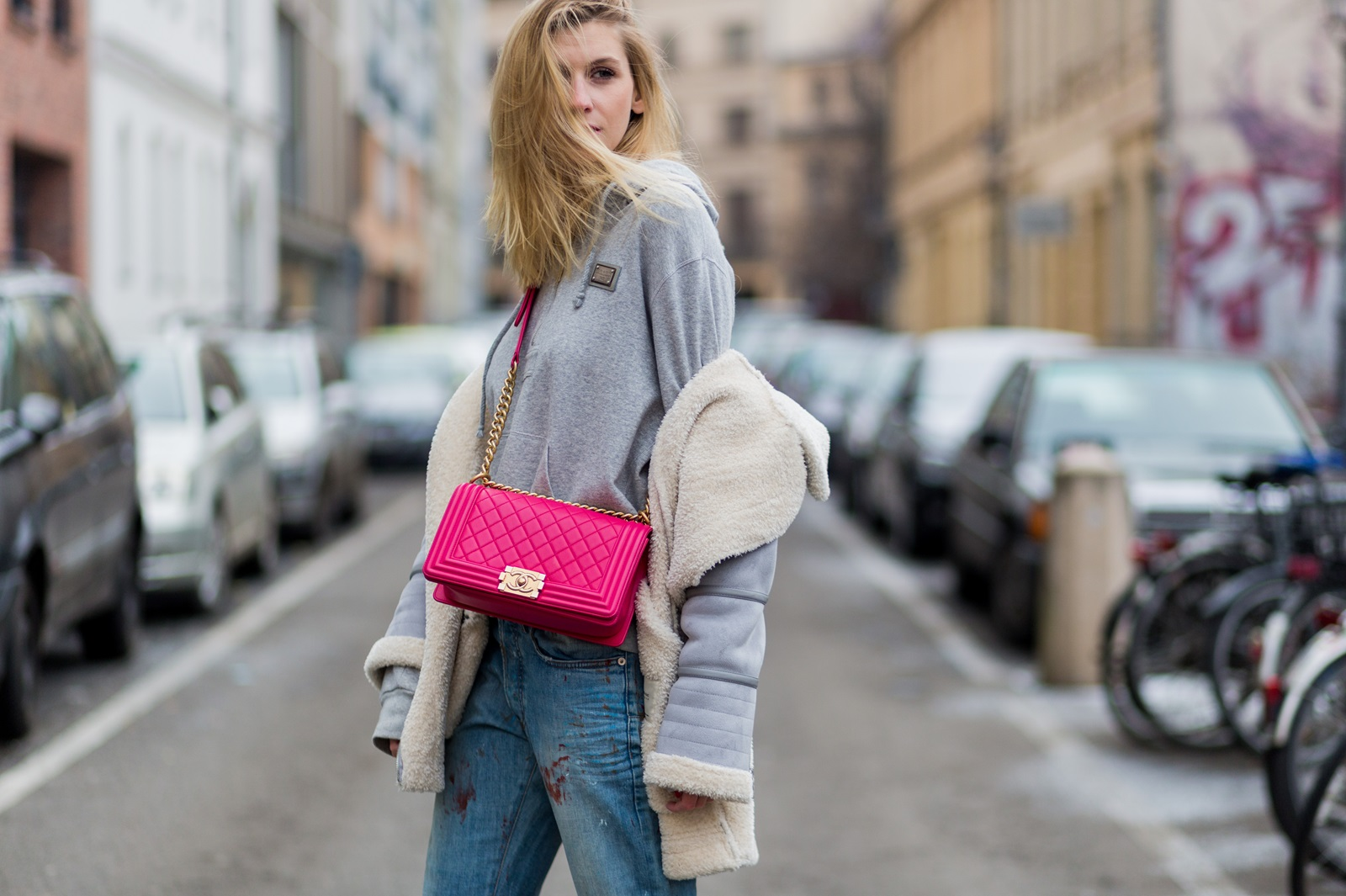 BERLIN, GERMANY - JANUARY 19: Kimyana Hachmann wearing Dior denim jeans, pink Chanel bag, Adidas Stan Smith sneaker, Zara jacket, Dolce & Gabbana hoody, during the Mercedes-Benz Fashion Week Berlin A/W 2017 at Kaufhaus Jandorf on January 19, 2017 in Berlin, Germany. (Photo by Christian Vierig/Getty Images) *** Local Caption *** Kimyana Hachmann