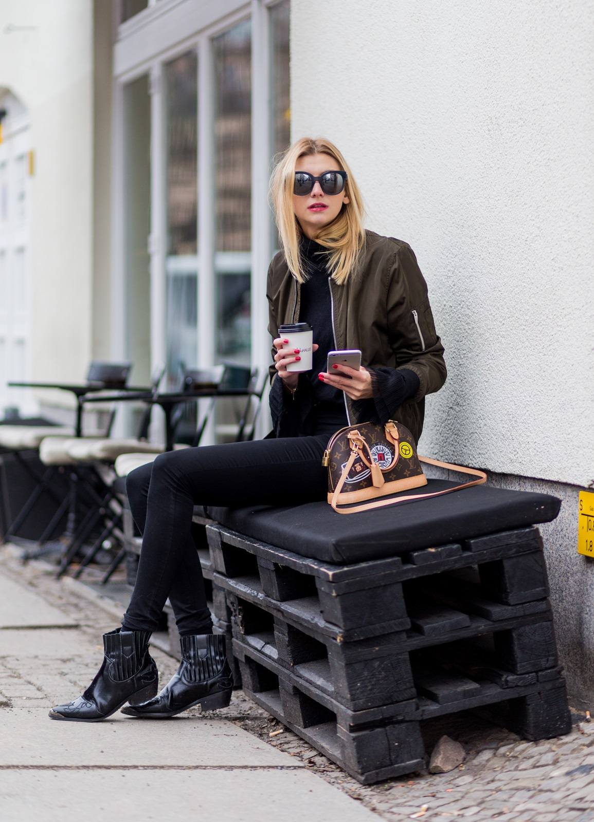 BERLIN, GERMANY - JANUARY 19: Kimyana Hachmann wearing a top and bomber jacket Zara, H&M pants, Mango ankle boots, Louis Vuitton bag, Chanel sunglasses during the Mercedes-Benz Fashion Week Berlin A/W 2017 at Kaufhaus Jandorf on January 19, 2017 in Berlin, Germany. (Photo by Christian Vierig/Getty Images) *** Local Caption *** Kimyana Hachmann